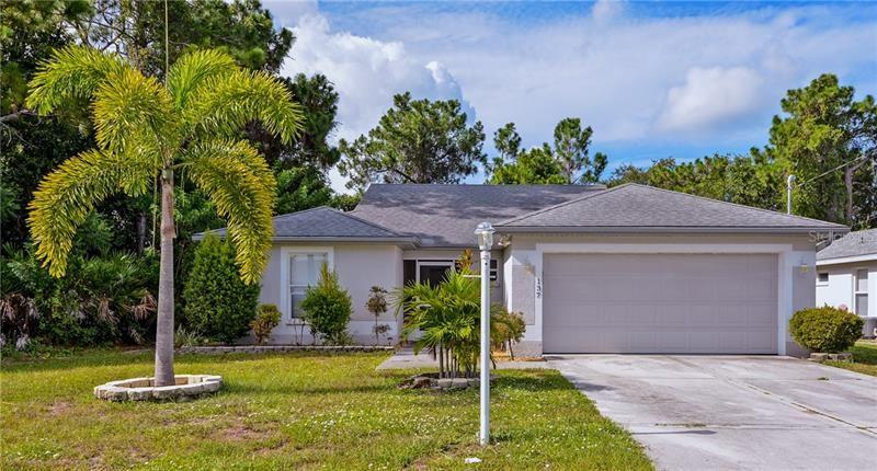Photo of 137 SWAN DRIVE, ROTONDA WEST, FL 33947 (MLS # D6112916)