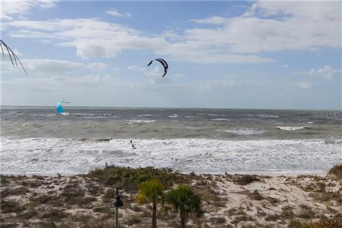 Photo of 403 GULF WAY #402, ST PETE BEACH, FL 33706 (MLS # U8110919)
