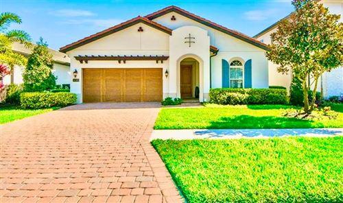 Photo of 10385 ROYAL CYPRESS WAY, ORLANDO, FL 32836 (MLS # O5924928)