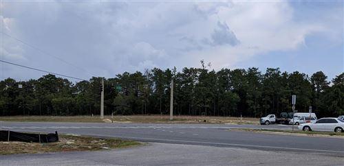 Photo of 10011 SW 484, OCALA, FL 34481 (MLS # OM565938)