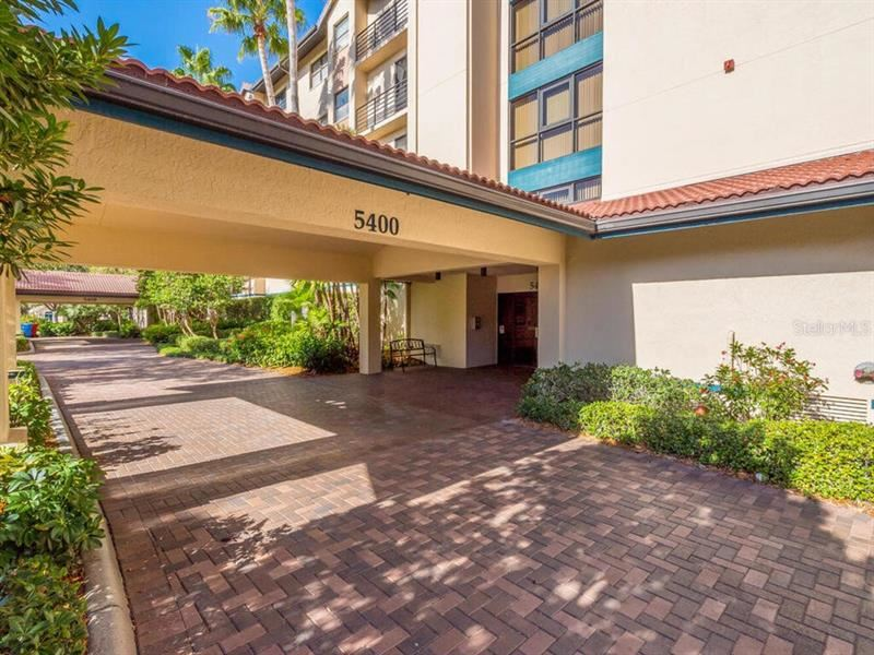 Photo of 5400 EAGLES POINT CIRCLE #406, SARASOTA, FL 34231 (MLS # A4478938)