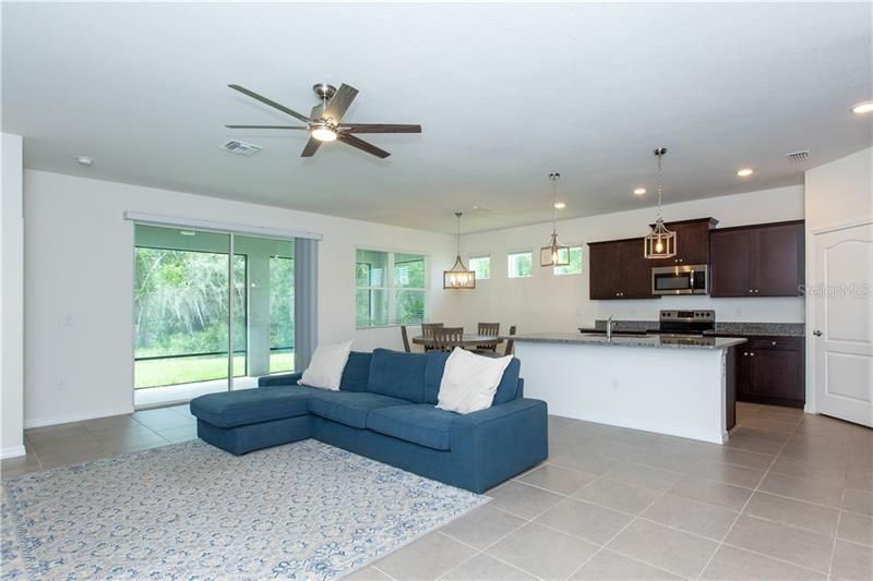 Photo of 13714 WOODBRIDGE TERRACE, BRADENTON, FL 34211 (MLS # U8097940)