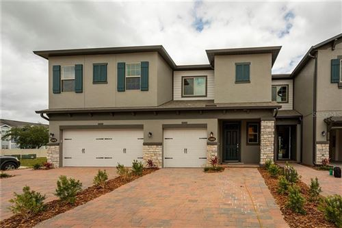 Photo of 12031 WHITE WAVE POINT, ORLANDO, FL 32828 (MLS # O5867949)