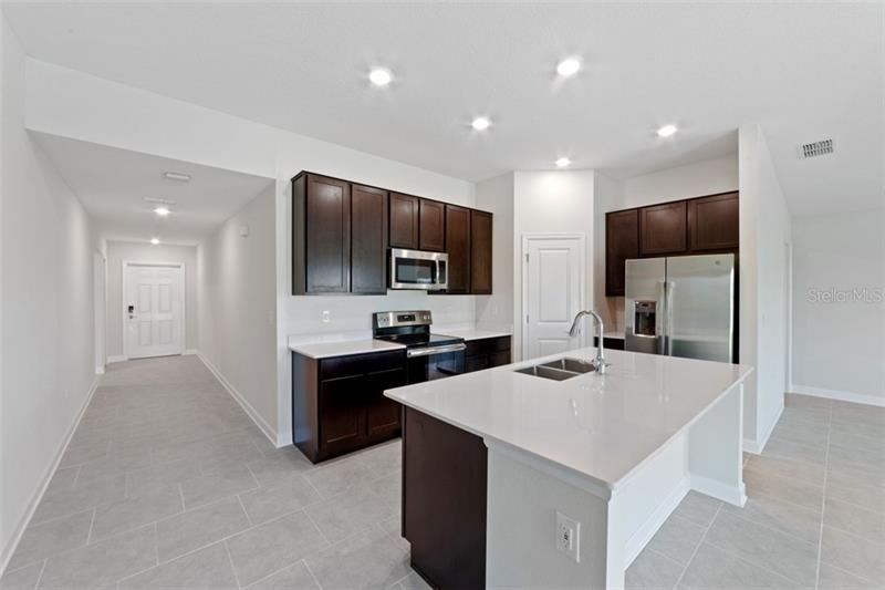 Photo of 412 N ANDREA CIRCLE, HAINES CITY, FL 33844 (MLS # T3285949)