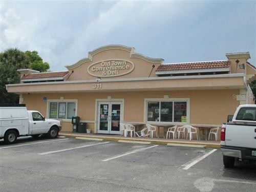 Photo of 311 W MARION AVENUE, PUNTA GORDA, FL 33950 (MLS # C7200950)