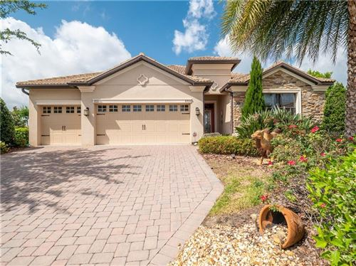 Photo of 8974 DOVE VALLEY WAY, CHAMPIONS GATE, FL 33896 (MLS # O5865955)