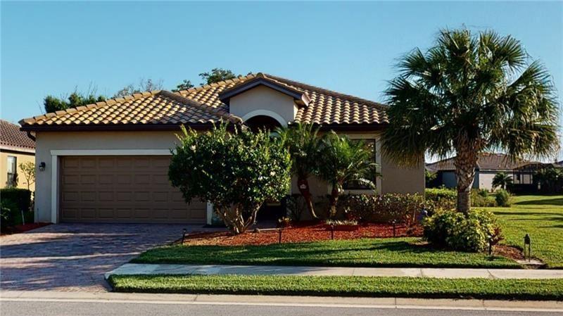 Photo of 6938 QUIET CREEK DR, BRADENTON, FL 34212 (MLS # A4496960)