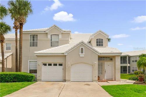 Photo of 7725 CARRIAGE HOMES DRIVE #13, ORLANDO, FL 32819 (MLS # O5867963)