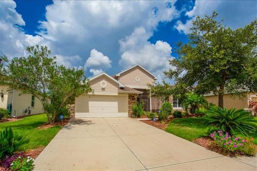 Photo of 8821 BRIDGEPORT BAY CIRCLE, MOUNT DORA, FL 32757 (MLS # O5880963)