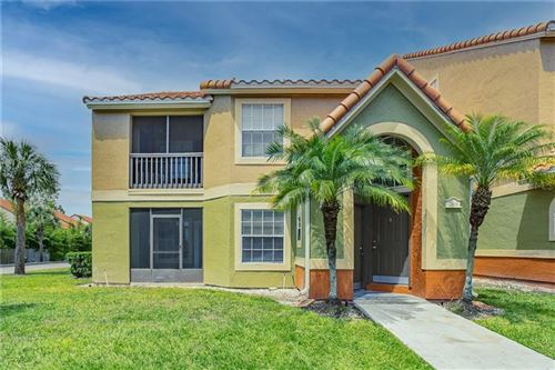 Photo of 405 FOUNTAINHEAD CIRCLE #144, KISSIMMEE, FL 34741 (MLS # U8119969)