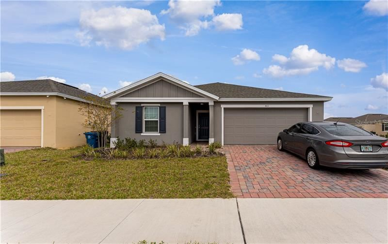 Photo of 461 MEADOW POINTE DRIVE, HAINES CITY, FL 33844 (MLS # O5846971)