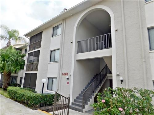 Photo of 2065 HUNTERS GLEN DRIVE #411, DUNEDIN, FL 34698 (MLS # T3286972)