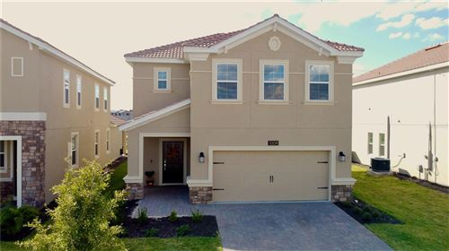 Photo of 1004 DOWNSWING PLACE, CHAMPIONS GATE, FL 33896 (MLS # O5981974)