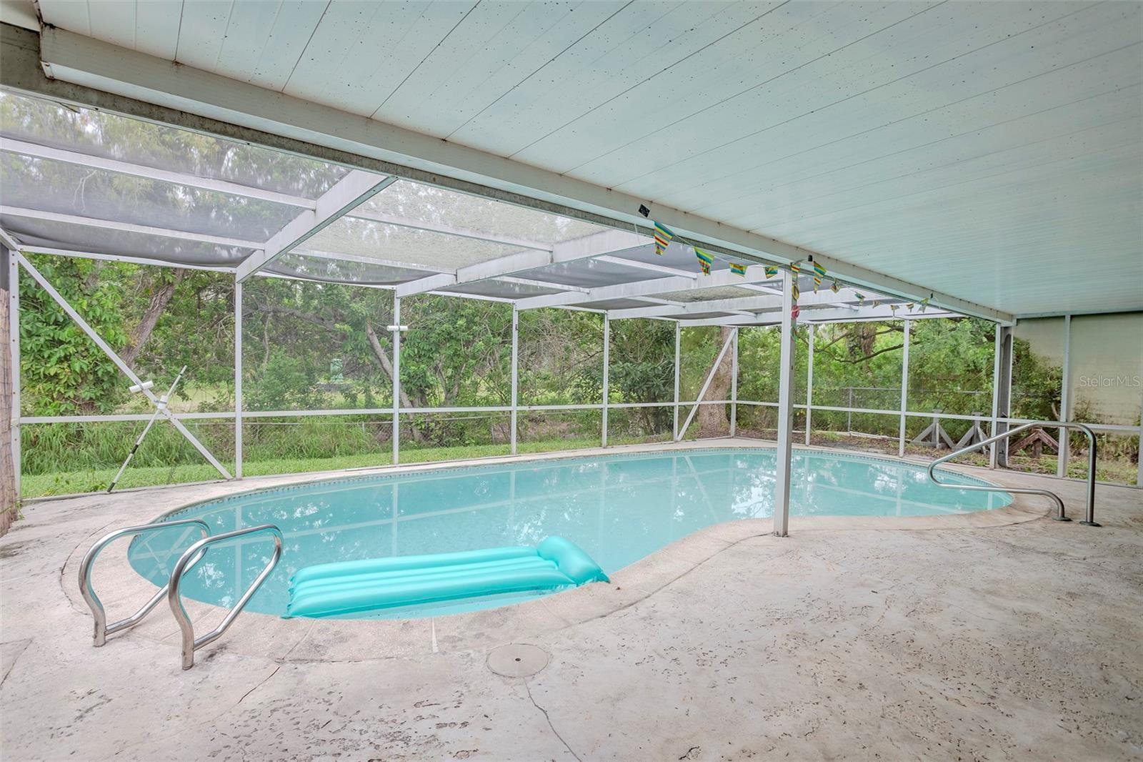 Photo of 10021 CHERRY CREEK LANE, PORT RICHEY, FL 34668 (MLS # U8131977)
