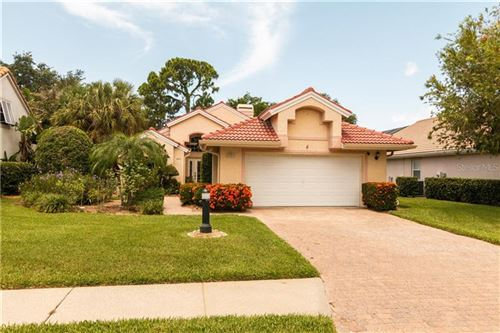 Photo of 5803 FAIRWOODS CIRCLE, SARASOTA, FL 34243 (MLS # A4470980)