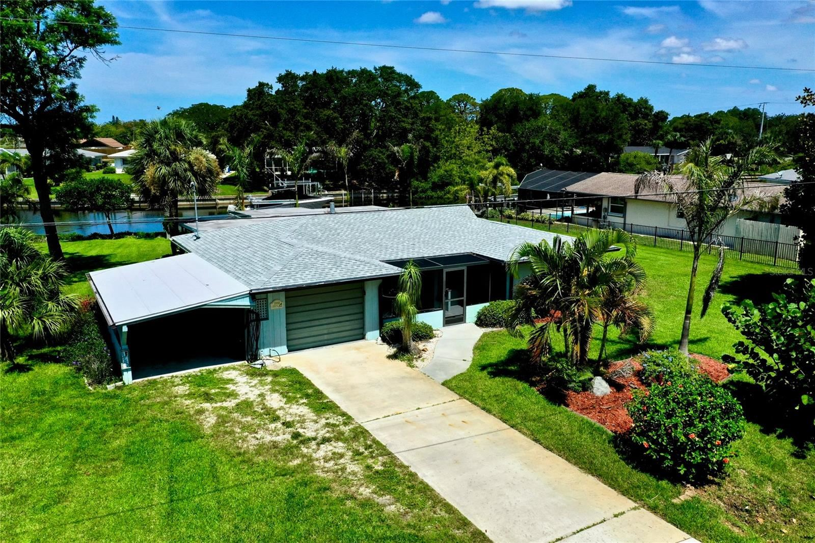 Photo of 1950 FORKED CREEK DRIVE, ENGLEWOOD, FL 34223 (MLS # D6119988)