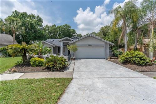 Photo of 14663 VILLAGE GLEN CIRCLE, TAMPA, FL 33618 (MLS # T3301989)
