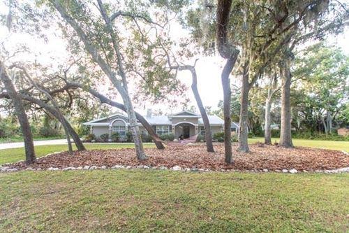 Photo of 6874 COUNTY ROAD 95, PALM HARBOR, FL 34684 (MLS # U8104989)