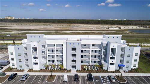 Photo of 3171 PARADOX CIRCLE #406, KISSIMMEE, FL 34746 (MLS # T3321995)