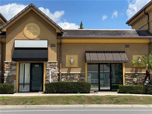 Photo of 215 E OAK STREET #215, KISSIMMEE, FL 34744 (MLS # S5049996)