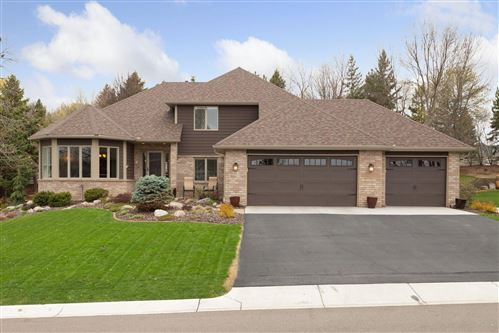 Photo of 8663 Comstock Lane N, Maple Grove, MN 55311 (MLS # 5743088)