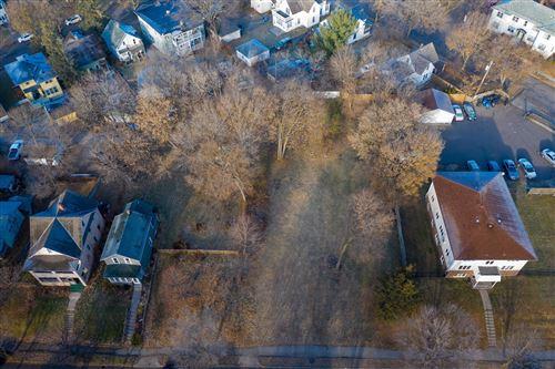 Photo of 147 Cedar Lake Road N, Minneapolis, MN 55405 (MLS # 5704120)