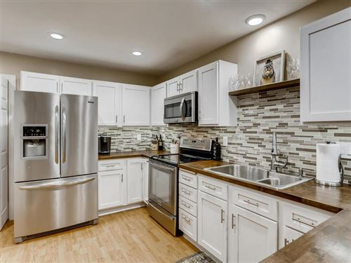 Photo of 1825 Donegal Drive #12, Woodbury, MN 55125 (MLS # 5607213)