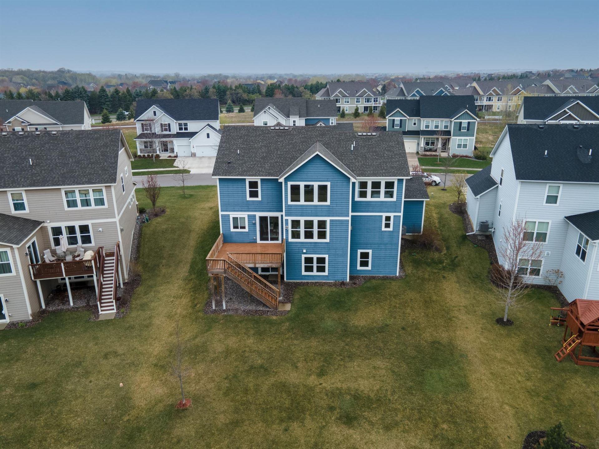 Photo of 1667 Bluewater Lane, Woodbury, MN 55129 (MLS # 5745235)