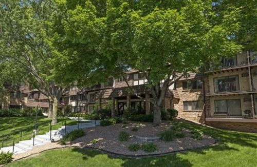 Photo of 215 Barry Avenue S #115, Wayzata, MN 55391 (MLS # 5572422)