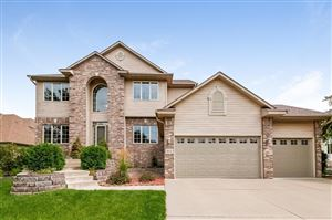 Photo of 10924 Woodland Drive N, Champlin, MN 55316 (MLS # 5279729)