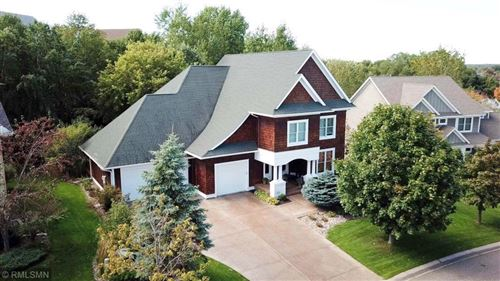 Photo of 11282 Stonemill Farms Curve, Woodbury, MN 55129 (MLS # 5351861)