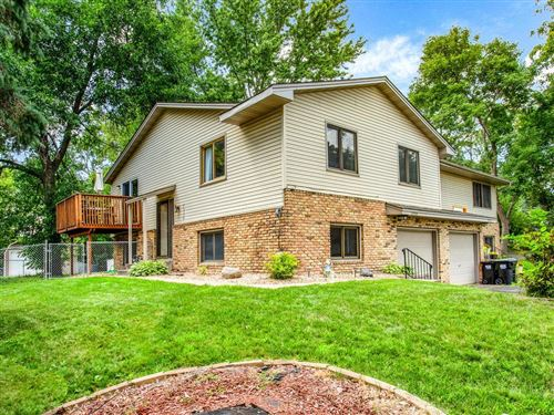 Photo of 10950 Robinson Drive NW, Coon Rapids, MN 55433 (MLS # 5636935)
