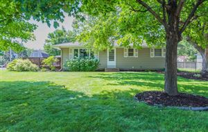 Photo of 11601 Idaho Avenue N, Champlin, MN 55316 (MLS # 5274993)