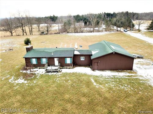 Photo of 5407 HOLLENBECK RD, Columbiaville, MI 48421-9391 (MLS # 40027032)