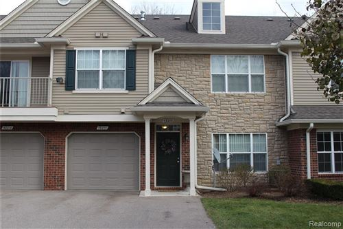 Photo of 49200 W WOODS DR, Shelby Township, MI 48317-1846 (MLS # 40006150)