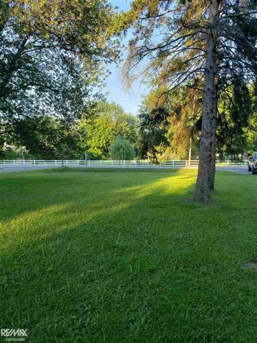Photo of 9380 River Rd, Algonac, MI 48001 (MLS # 50016152)