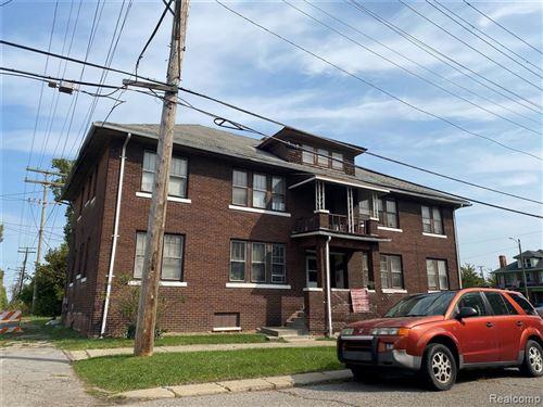 Photo of 9116 WOODROW WILSON ST, Detroit, MI 48206-2027 (MLS # 40112276)