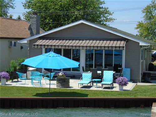 Photo of 4635 S CHANNEL DR, Harsens Island, MI 48028-9634 (MLS # 40073297)