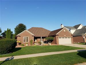 Photo of 49505 DUNHILL DR, Macomb Township, MI 48044-1740 (MLS # 30784341)