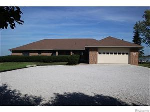 Photo of 5472 MIDDLE CHANNEL DR, Harsens Island, MI 48028-9543 (MLS # 21656428)