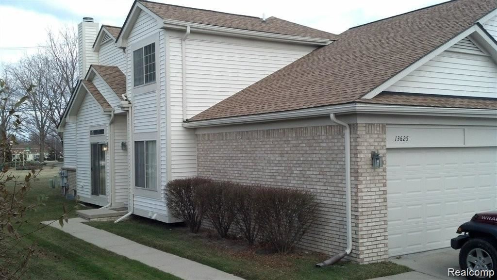 Photo of 13625 SUMMER WOOD DR, Sterling Heights, MI 48312-5607 (MLS # 40007511)