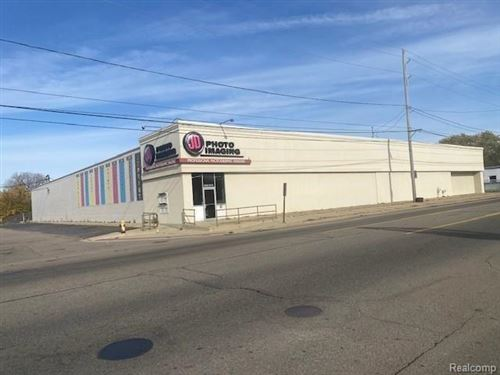 Photo of 3018 CORUNNA RD, Flint, MI 48503-3258 (MLS # 40238522)