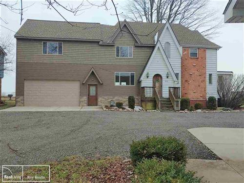Photo of 29818 Jefferson Ave, Saint Clair Shores, MI 48082 (MLS # 50003582)