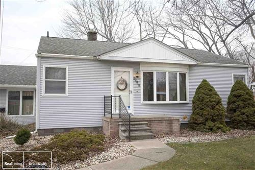 Photo of 22918 Masonic Blvd, Saint Clair Shores, MI 48082 (MLS # 50028766)