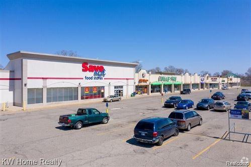 Photo of 1595 HOLMES RD, Ypsilanti, MI 48198-4147 (MLS # 40238822)