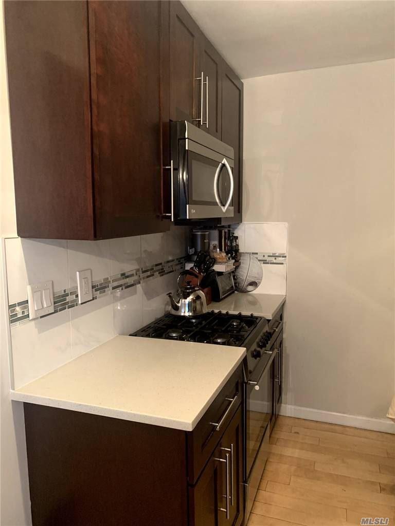 Photo of 6701 136th Street #A, Kew Garden Hills, NY 11367 (MLS # 3265015)