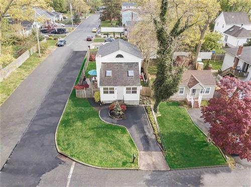 Photo of 62 Magnolia Ave, Lake Grove, NY 11755 (MLS # 3215192)