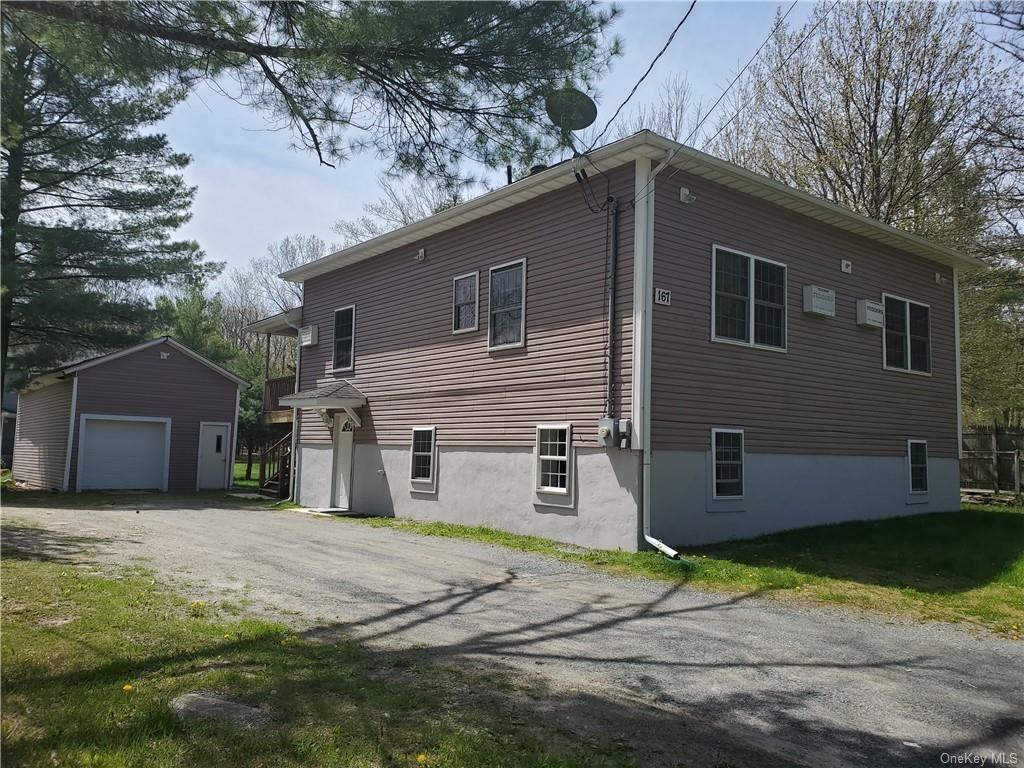 Photo of 167 Yankee Lake Road, Wurtsboro, NY 12790 (MLS # H6040370)
