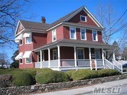 Photo of 123 Maple Avenue #202, Riverhead, NY 11901 (MLS # 3162372)