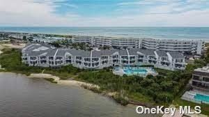 Photo of 253 Dune Rd. #49, Westhampton Bch, NY 11978 (MLS # 3336434)